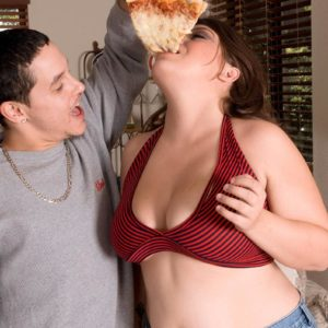 Plus-sized girl Lola Lush letting her large fun bags loose while tonguing pizza and giving oral sex