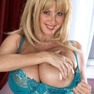 Sandy-haired sweetheart Penny Porsche unveiling fine juggs for self nipple gobbling