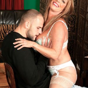 Sexy MILF over 60 Lexi McCain seducing younger boy in white hosiery and lingerie