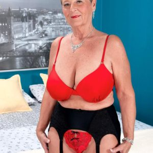 Short haired grannie Joanne Price seducing younger man in nylons and garter