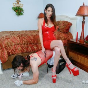 Clothed brown-haired Bossy type Dava Foxx instructing crossdressing sissy maid with crop