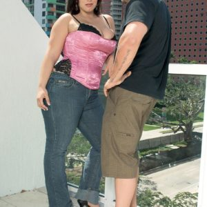 Curvaceous black-haired MILF London Andrews pulling out funbags for nip eating in denim jeans