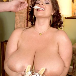 Curvy female Maria Moore flaunting humungous boobies while sucking food and giving BLOW JOB