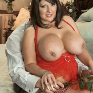 Dark haired MILF Angel Gee unsheathing large tits from see through dress for nip slurping