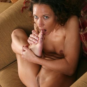 Experienced brown-haired doll with amazing legs sucking her own toes after stripping