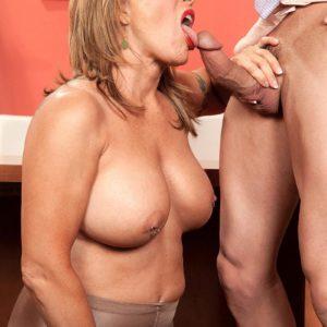 Hose garbed older office employee Luna Azul uncovering massive breasts before delivering BLOW-JOB