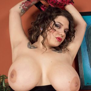Marvelous solo stunner Ariana Angel extracting boobs wearing leg warmers and micro-skirt