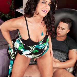 Over Fifty dark haired Azure Dee giving younger man hand-job before doggy screwing