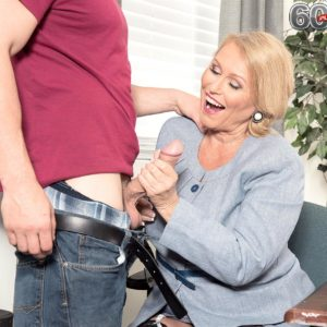 Plumper broad over sixty Alice sucking and giving humungous sausage hand job in work place place