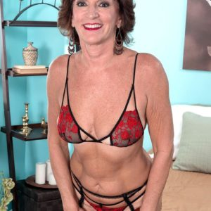 Stocking, garter and lingerie outfitted 60 plus MILF Sydni Lane freeing ass for sex acts
