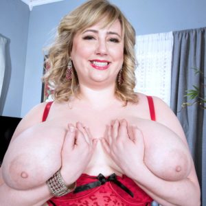 Ash-blonde big hot woman solo model Laddie Lynn letting gigantic floppy juggs free from lingerie