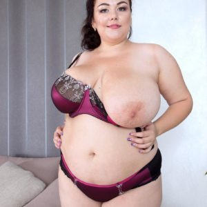 Black-haired BIG HOT LADY Mariya Mills letting gigantic saggy tits free from sundress and brassiere in hosiery