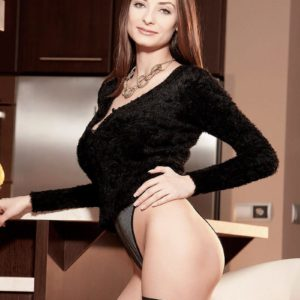 Brown-haired babe Estelle Taylor vaunting massive all-natural breasts in black hose and pumps