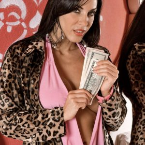 Busty black-haired adult film star Veronica Rayne having fun bags sucked in exchange for money