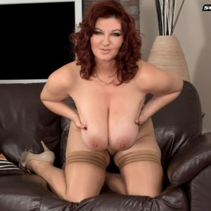 Chubby solo girl Vanessa Y flaunting hefty all natural dangling tits in hosiery