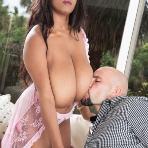 Dark-haired black MILF Rachel Raxxx revealing large floppy fun bags from see-through lingerie