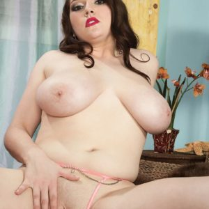 Dark haired MILF Kate Marie exposing gigantic all natural tits while undressing