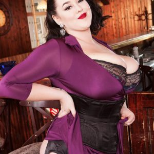 Dark haired MILF Lila Payne unleashing immense fun bags in ebony garters and hose