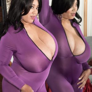 Dark haired MILF Roxi Red letting monster-sized hooters free from violet onesie