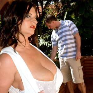 Dark haired solo girl Maria Moore pulling out immense fun bags outdoors in cut-offs