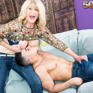Enticing senior gal Kendall Rex letting monster-sized boobies loose while seducing younger man