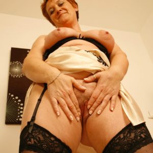 mature redhead gf lets out big natural funbags after demonstrating no panty upskirt