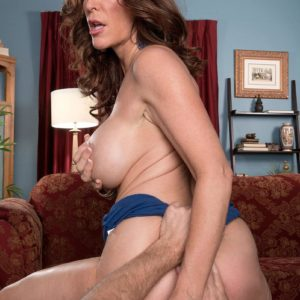Over 50 MILF Rachel Steele unsheathing massive juggs before having slit slurped out on sofa