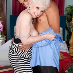 Over 60 MILF adult film star Jewel having hefty tits freed from dress in hosiery and pumps