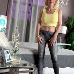 Over Fifty ash-blonde MILF Cammille Austin de-robe naked by ebony stud before interracial sex