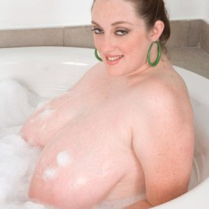 Over weight solo female Alice Webb letting hefty wet melons suspend free in the tub