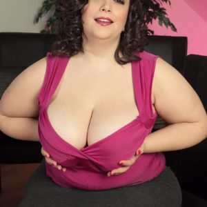 Overweight black-haired solo model Mia Beauty undressing down to her bra and panties
