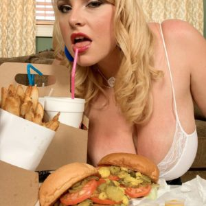 Plus sized yellow-haired female Scarlett Rouge eating food while engaging in blowjob activities