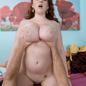Red-haired model Felicia Clover freeing large knockers and immense butt before sex