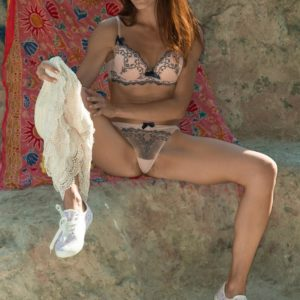 Slim first-timer Scarlett Nika gliding off panties outdoors for hairy vag spreading