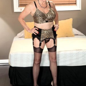Stocking outfitted granny Bea Cummins providing BIG EBONY COCK hand job in heels and girdle