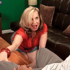 Blonde MILF over 60 Miranda Torri revealing massive natural boobies and bare ass