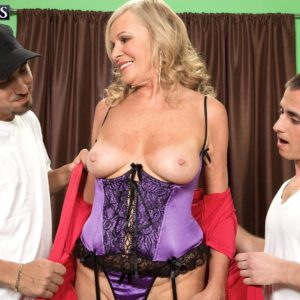 Experienced ash-blonde porno star Bethany James milking 2 penises in lingerie and nylons
