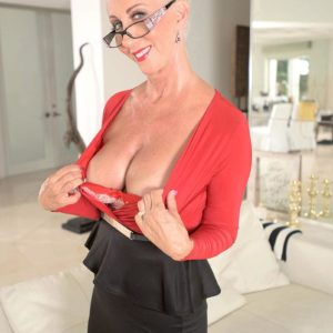 Experienced yellow-haired XXX film star Madison Milstar loosing gigantic melons and upskirt undies