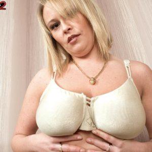 Fair-haired MILF Vanessa Lilio vaunting upskirt panties before exposing big boobs