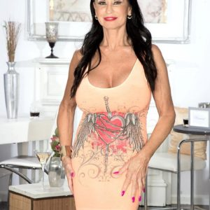 Over Sixty brown-haired MILF Rita Daniels showcasing great legs and big funbags