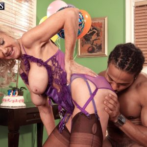 Stocking and lingerie clad aged yellow-haired Summeran Winters having bi-racial sex