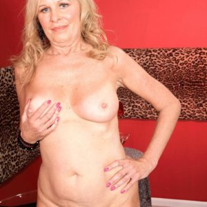 Huge-chested blonde mature doll Bethany James flaunting humungous juggs and upskirt panties