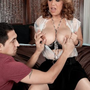 Latina solo girl Marisa Carlo unsheathing nice juggs and upskirt bloomers in high-heels