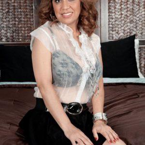 Latina solo girl Marisa Carlo unsheathing nice juggs and upskirt bloomers in high-heels