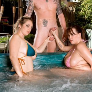 Big-boobed MILF lesbos Brandy Talore and April McKenzie giving hand-job in pool