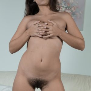 Brown-haired amateur Camille S flashing small knockers before spreading fur covered cooter