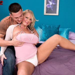 Inked ash-blonde babe Sabrina Linn releasing big hooters for pierced nip slurping