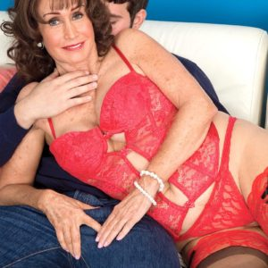 Lingerie attired dark-haired grandmother Jacqueline Jolie unveiling huge melons for nipple gobbling