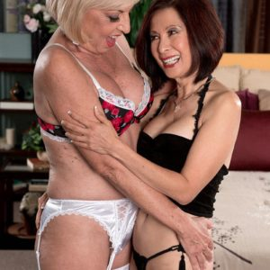 Mature lesbos Scarlet Andrews and Kim Anh having multiracial 3 way sex