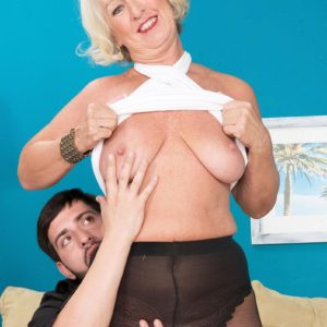 Pantyhose and skirt adorned grandmother Jeannie Lou blowing humungous penis on knees
